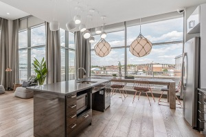 floor-to-ceiling windows brighten spacious, open concept clubhouse
