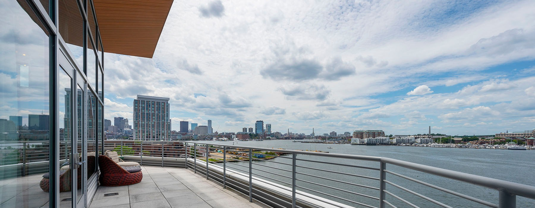 clubhouse balcony provides views of the harbor and downtown Boston